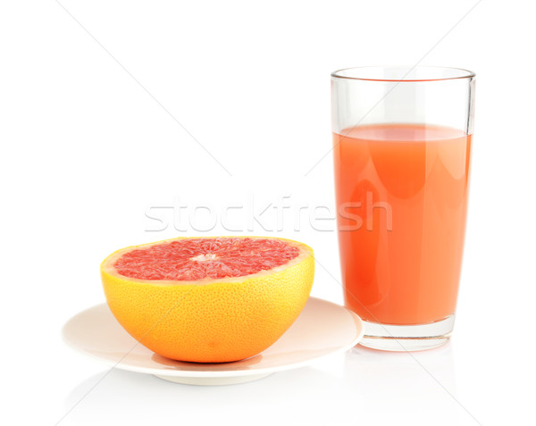 Studio shot sliced grapefruit on plate with juice isolated white Stock photo © dla4