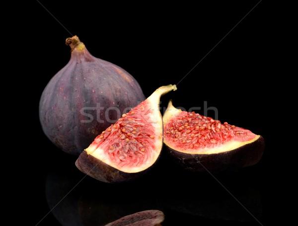 Quarters of figs isolated on black background  Stock photo © dla4