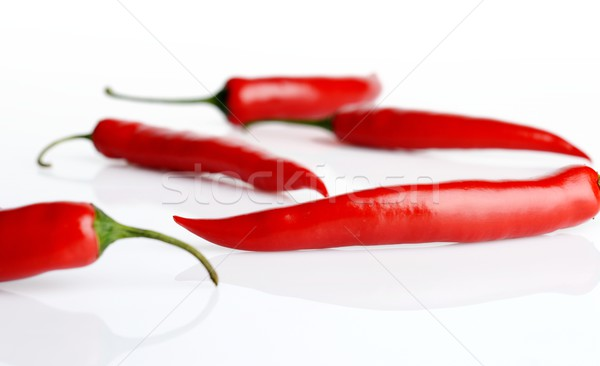 Studio shot of chilli peppers on white Stock photo © dla4