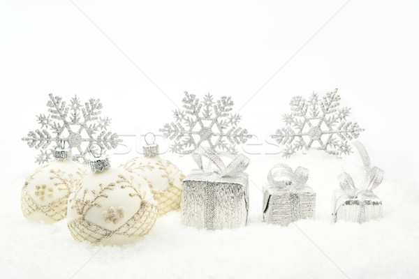 Silver christmas gifts,baubles ribbon on snow Stock photo © dla4