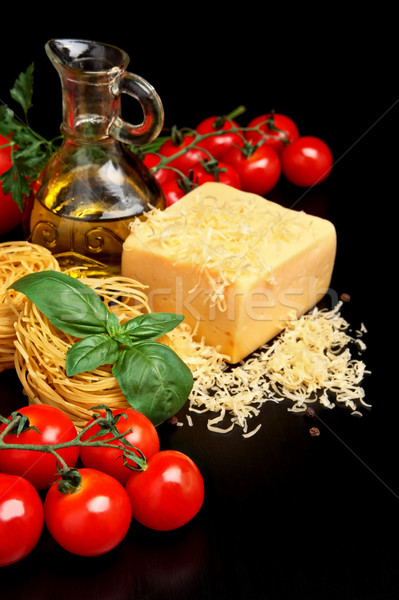 Round balls of pasta with cheese, tomatoes,basil,olive oil on black Stock photo © dla4