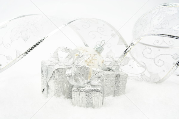 Silver christmas gifts with silver ribbon on snow Stock photo © dla4