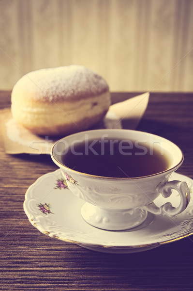 Doughnut with cup of coffee in old-fashioned room   Stock photo © dla4