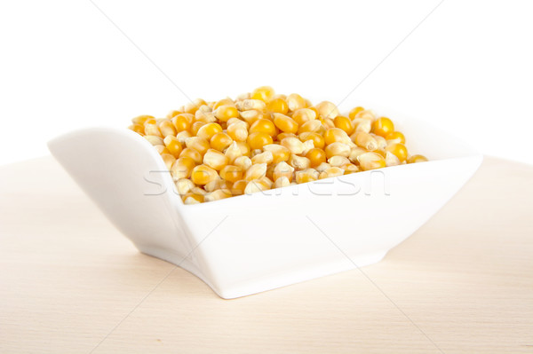 Salad-bowl full of dried raw corn on wooden table Stock photo © dla4