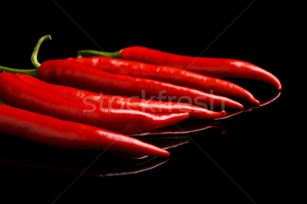 Perspective view of red peppers isolated black background Stock photo © dla4