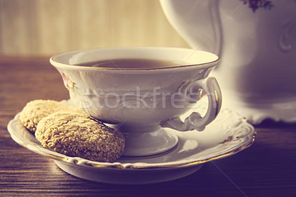 Csészék tea sütik klasszikus hatás porcelán Stock fotó © dla4