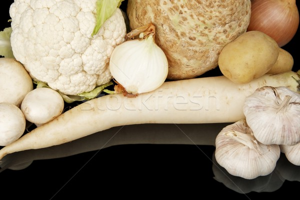 Collection of white vegetables on black top view Stock photo © dla4