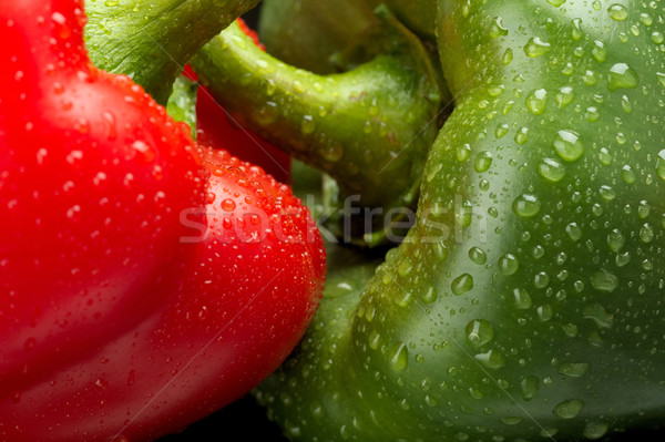 Cut shot of green,red bell pepper background with water drops Stock photo © dla4