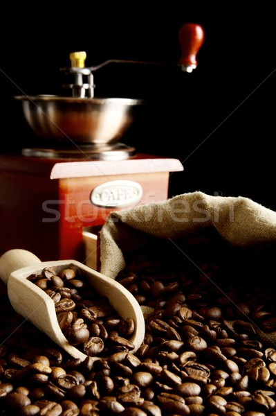 Zak vol koffiebonen zwarte zak geïsoleerd Stockfoto © dla4