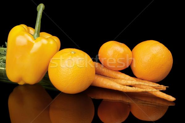 Set of orange fruits-mandarin,orange,carrots on black at the bottom Stock photo © dla4