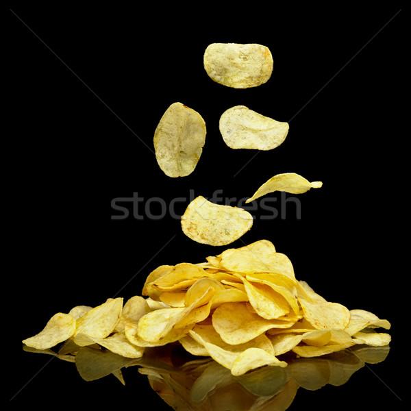куча картофельные чипсы падение чипов многие продовольствие Сток-фото © dla4