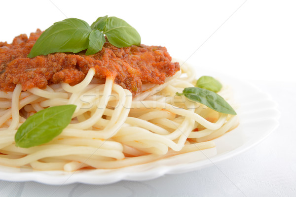 Close up pasta with bolognese sauce on white,cropped shot Stock photo © dla4