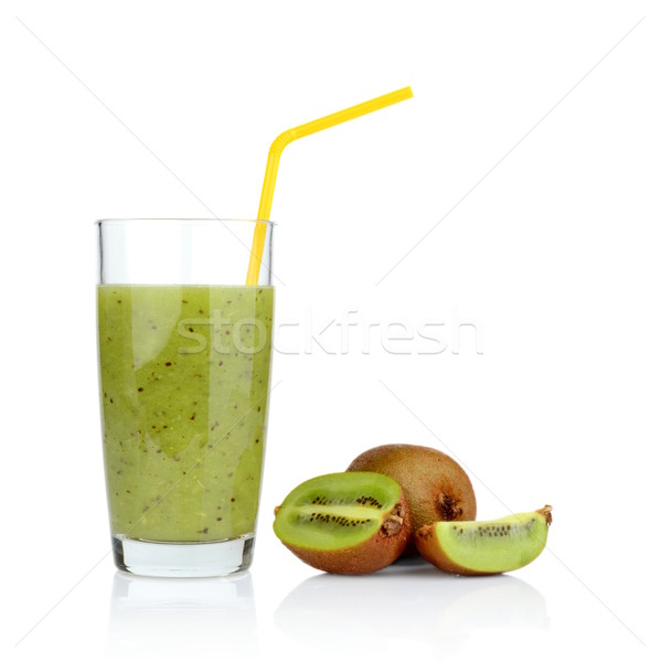Group of sliced kiwi with juice studio shot white background with straw Stock photo © dla4