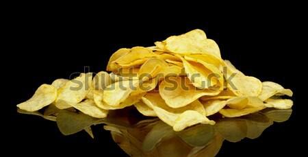 Estoque batatas fritas preto muitos comida grupo Foto stock © dla4