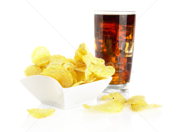 Salted potato chips in the salas-bowl with cola on white Stock photo © dla4