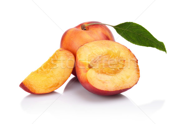 Few sliced nectarines with leaf isolated on white Stock photo © dla4