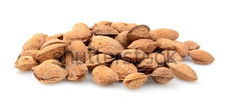 Group of almonds with shell isolated on white Stock photo © dla4