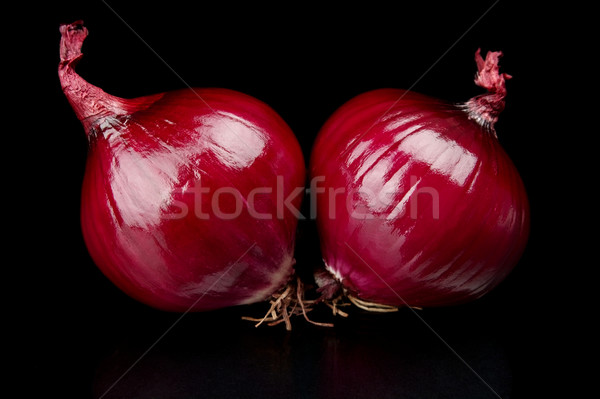 Red onions isolated on black Stock photo © dla4