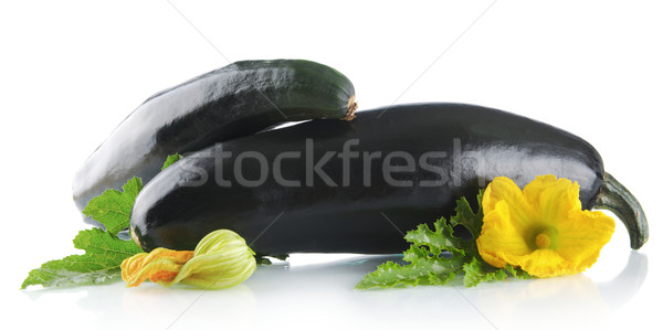 Mature courgettes with flowers on white background Stock photo © dla4