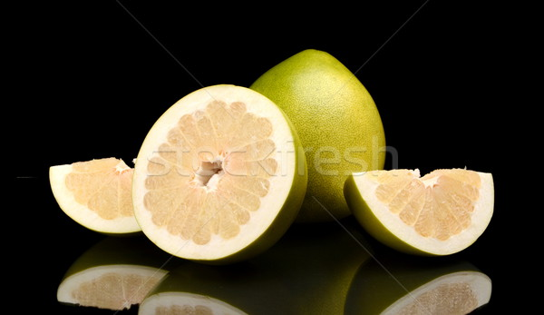 Four pomelos,half,quarter isolated on black Stock photo © dla4