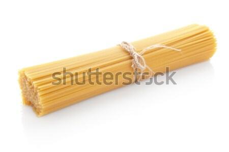 Hosszú spagetti nyers izolált fehér tészta Stock fotó © dla4