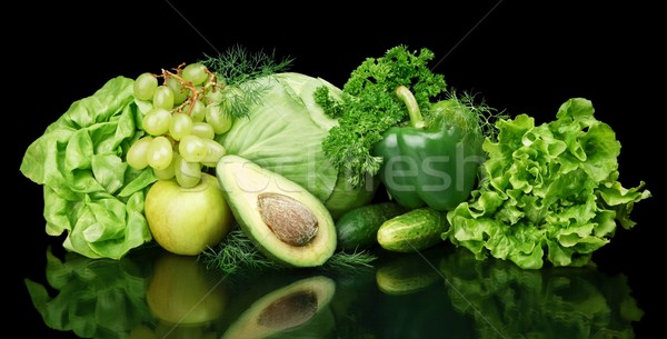 Collection of green vegetables and fruits on black Stock photo © dla4