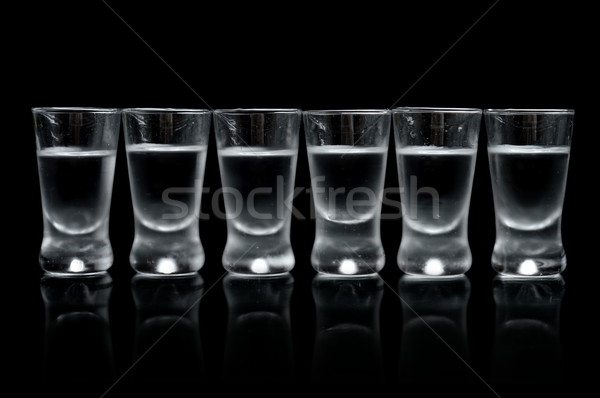 Many glasses of vodka isolated on black background Stock photo © dla4