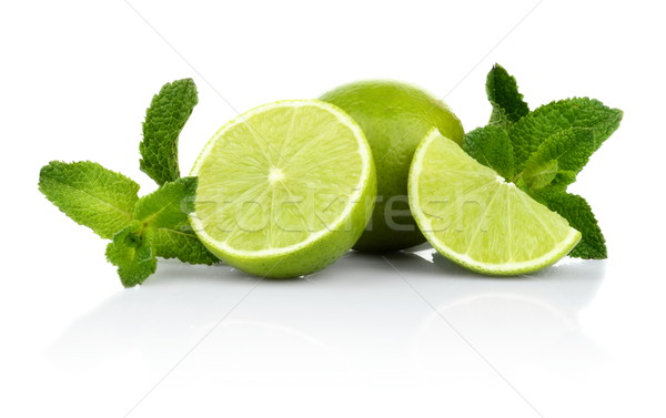 Three sliced limes with mint isolated on a white background Stock photo © dla4