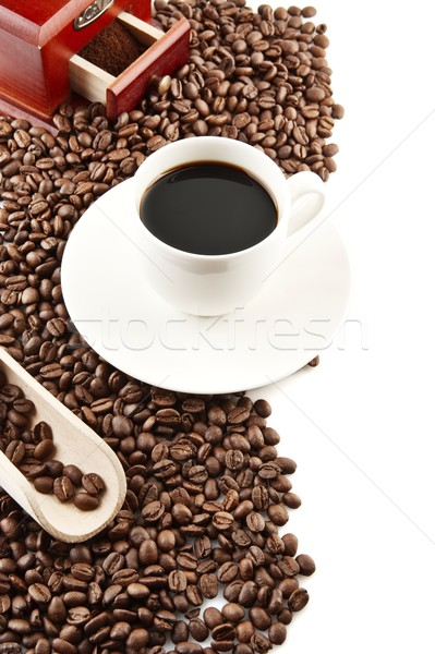 Cup of coffee with saucer and mill background Stock photo © dla4
