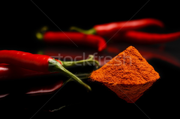 Studio shot chilli pepper, cayenne pepper isolated on black Stock photo © dla4