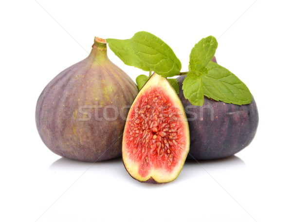 Three sliced figs with mint isolated on white background  Stock photo © dla4