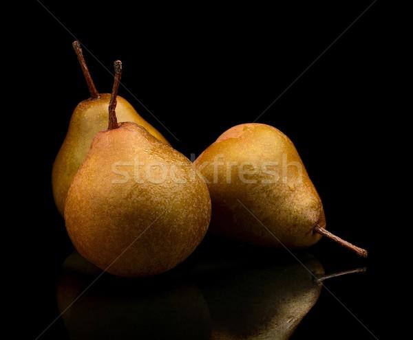 Drie peren geïsoleerd zwarte foto Stockfoto © dla4