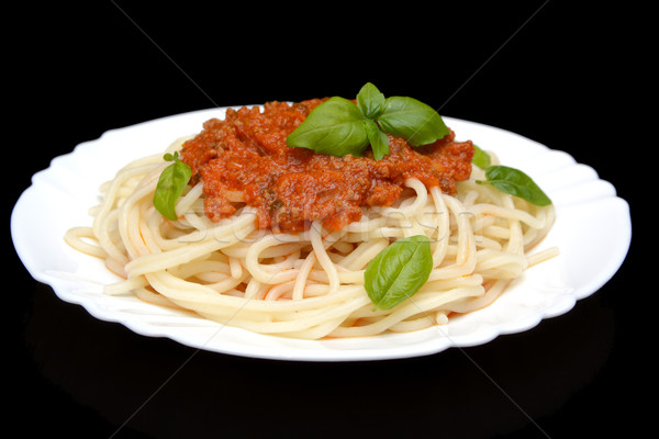 Spaghetti ragu bolognese sauce on black,close up Stock photo © dla4