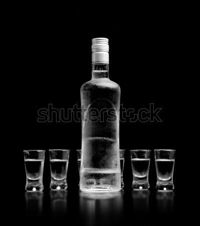 Bouteille verre vodka permanent isolé noir Photo stock © dla4