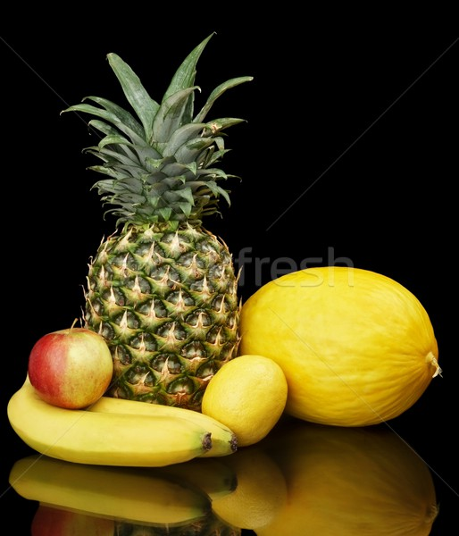Collection of yellow fruits on black Stock photo © dla4