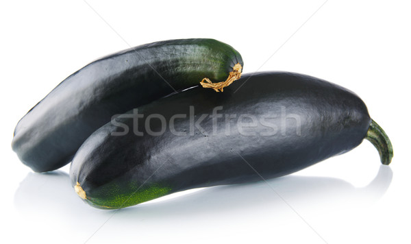 Black courgettes on white background Stock photo © dla4