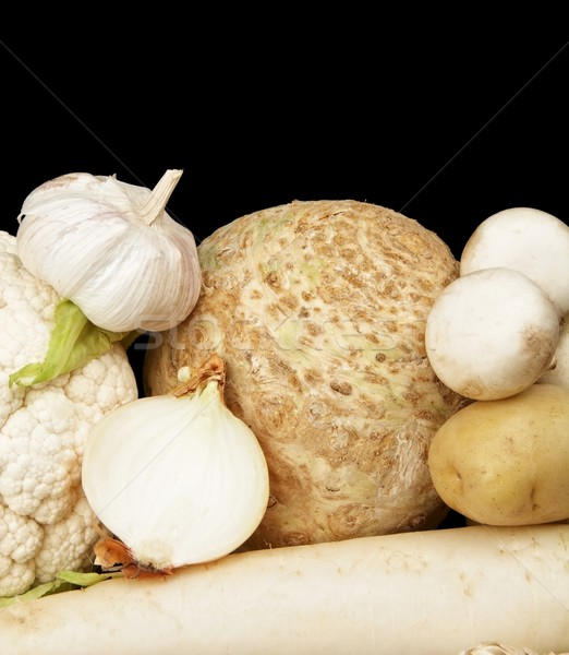 Collection of white vegetables on black bottom view Stock photo © dla4