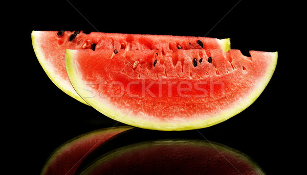 Slices and slice watermelon isolated black Stock photo © dla4