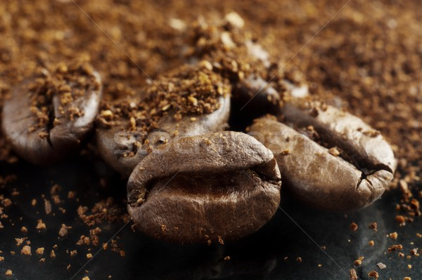 Closeup shot of coffee powder and beans on black Stock photo © dla4