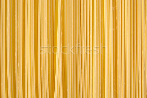 Background made of raw pasta stacked vertically Stock photo © dla4