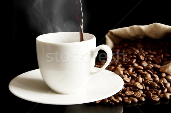 Koffie beker vol zak geïsoleerd zwarte Stockfoto © dla4