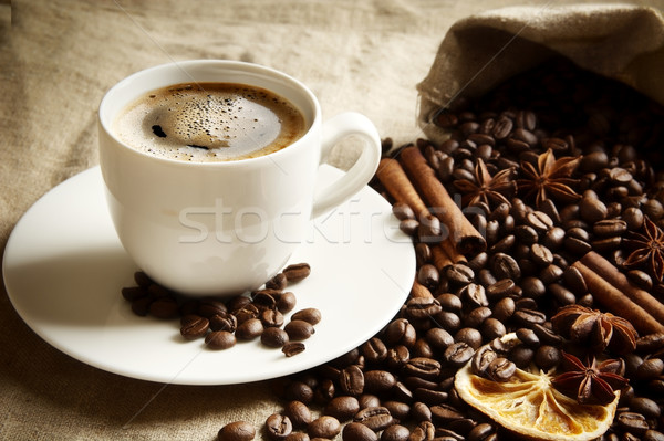 Cup of coffee with bag full of coffee,spices on linen Stock photo © dla4