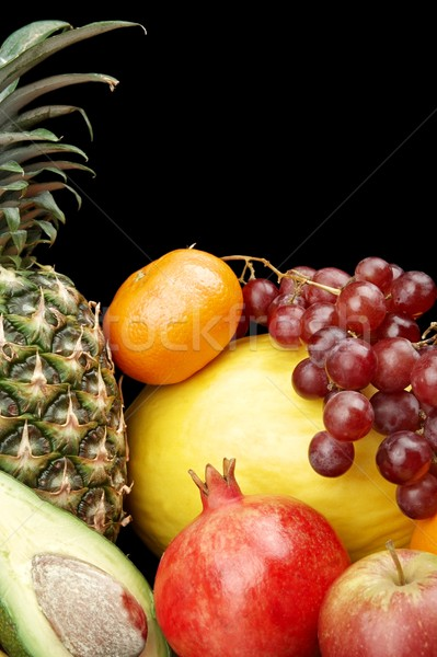Cropped vertical view of many colorful fruits on black with reflection Stock photo © dla4