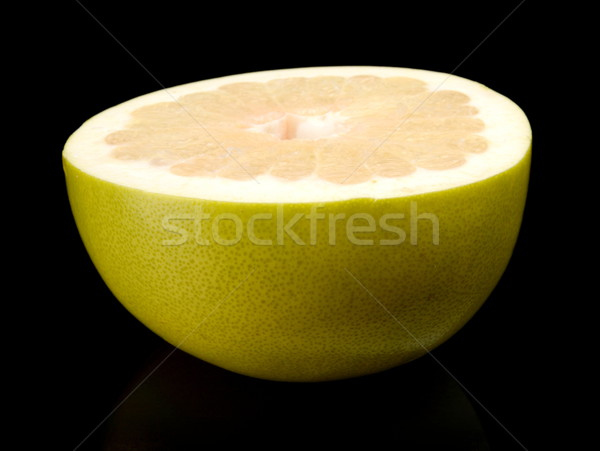 Half of pomelo, chinese grapefruit isolated on black Stock photo © dla4