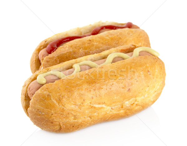 Hot dog with mustard and ketchup on white Stock photo © dla4