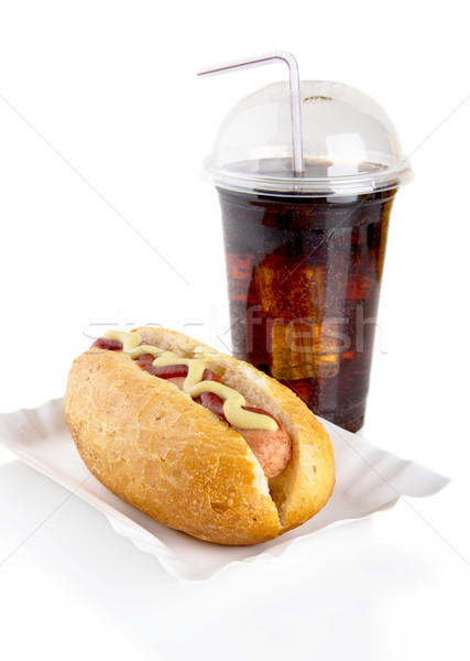 Hotdog with mustard and ketchup in the tray with cola on white  Stock photo © dla4