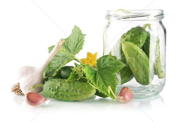Ingredients for pickling or preserves cucumbers on white Stock photo © dla4