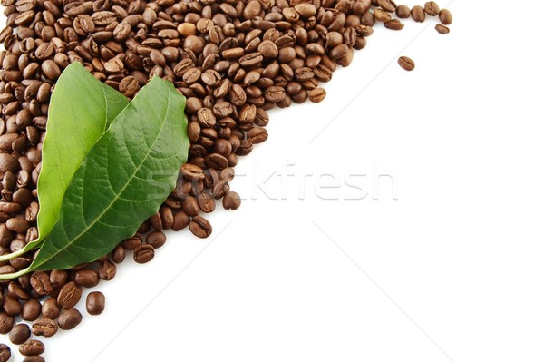 Collected coffee beans in the corner with leaf on white Stock photo © dla4