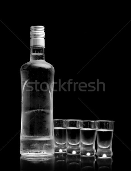 Botella muchos gafas vodka aislado negro Foto stock © dla4