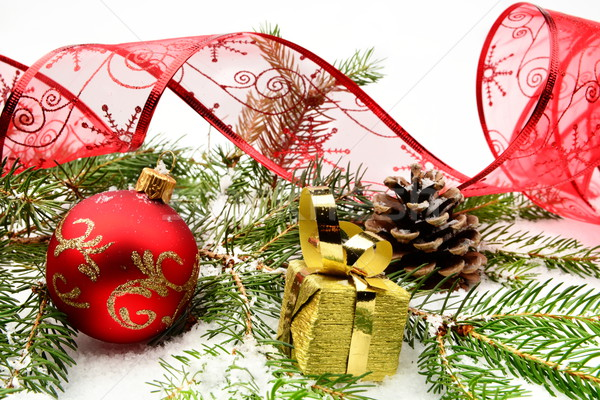Golden christmas gifts,baubles with red ribbon and needles fir o Stock photo © dla4
